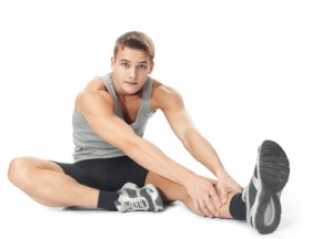 Athlete man doing stretches exercises