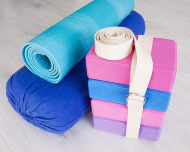 yoga props blocks, strap, roller and carpet